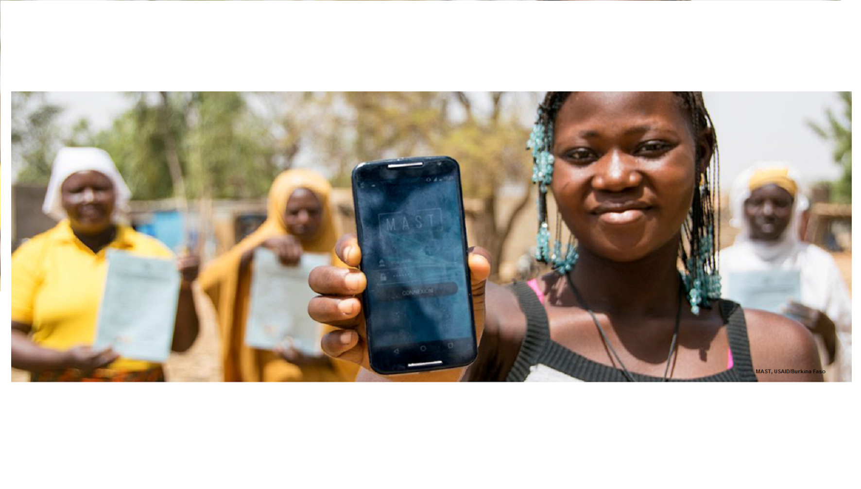 Girl with cell phone, MAST, USAID Burkina Faso