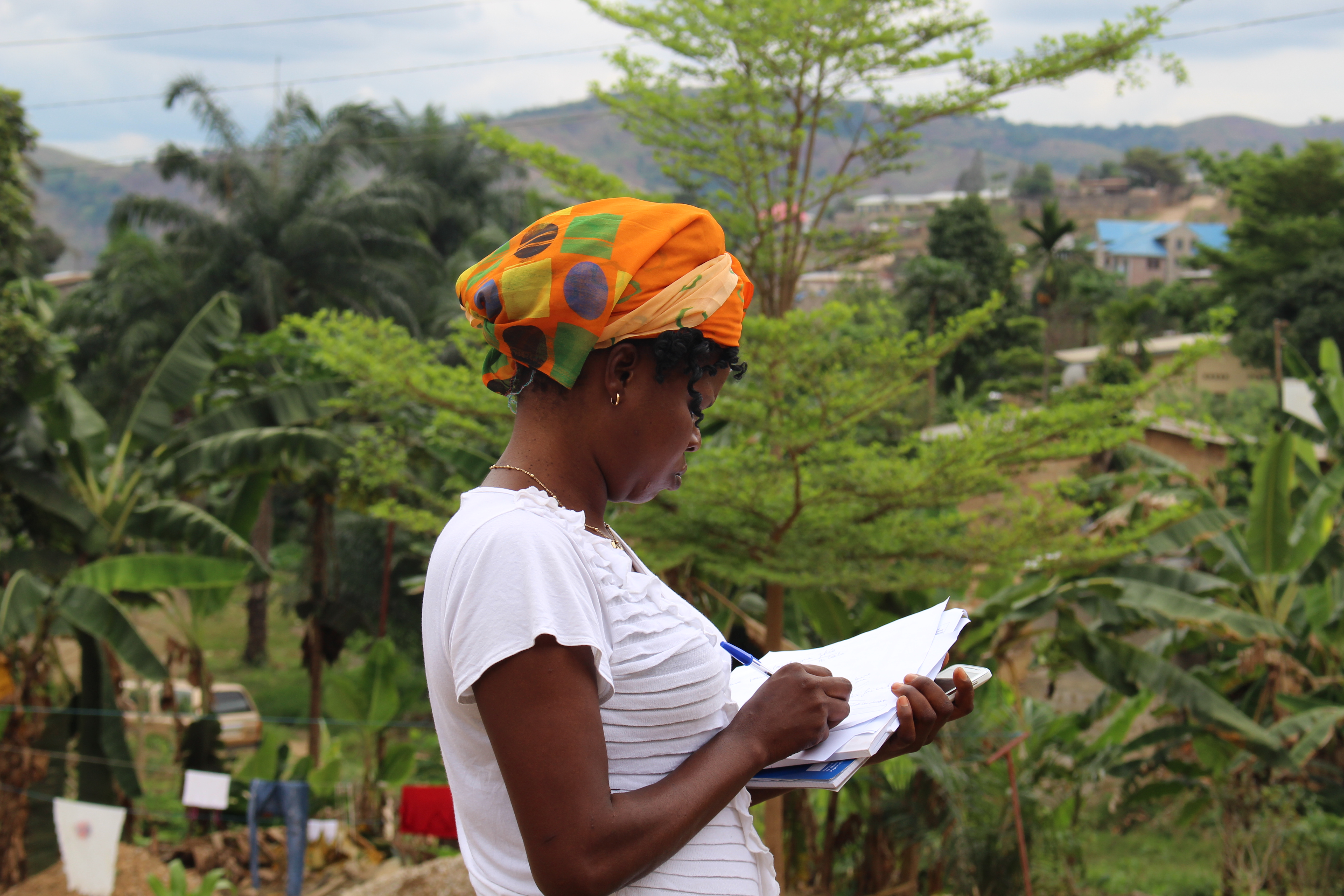 A resident enumerator in Congo (Kinshasa), prepares for another round of data collection for PMA2020, a mobile technology-based survey project that supports routine, rapid-turnaround, high quality data on family planning and other health indicators. © 2015 PMA2020/Shani Turke, Courtesy of Photoshare