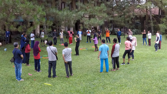 Youth participants, including persons with disabilities, gather for morning exercise during the Mitra Kunci Youth Camp in Lembang West Java